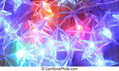 Illumination garland stars decoration blinking background.