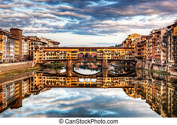 Ponte Vecchio bridge in Florence, Italy Arno River under...