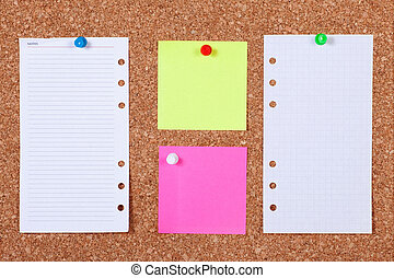 Notes on Corkboard - Pieces of note paper on a cork bulletin...