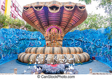 Durga Puja - Beautiful Durga idol in a snake shaped pandal...