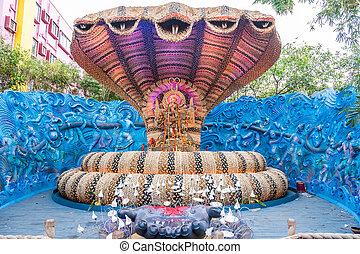Durga Puja - Beautiful Durga idol in a snake shaped pandal...