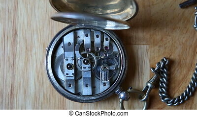 Old pocket watch mechanism movement - Macro video on an old...