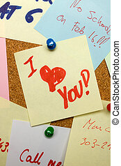 Love note pinned on cork board