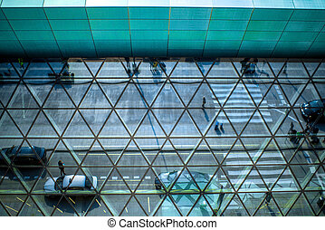Modern airport terminal facade with cars and peoples...