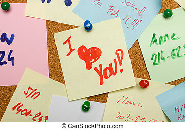 Love message pinned on cork board
