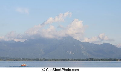 Boats on Chiemsee - Boats on the Chiemsee lake with alp...