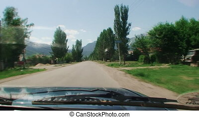 Driving on bad country road. the view through the windshield...