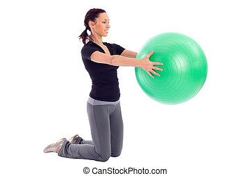 Gym Ball Exercise - Young woman working out with gym ball,...