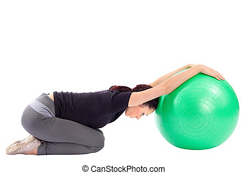 Woman Doing Gym Ball Exercise - Young woman working out with...