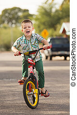 Laughing Child on Bike - Cute laughing child playing...