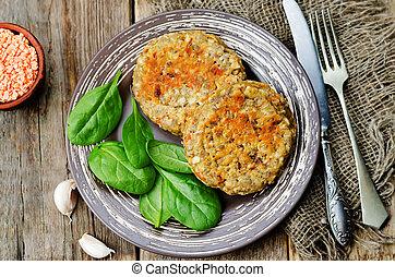 red lentil seeds cashew carrot burgers on dark wood...