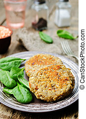 red lentil seeds cashew carrot burgers on dark wood...