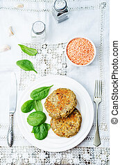 red lentil seeds cashew carrot burgers on white background....