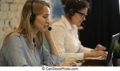 Two beautiful businesswoman working