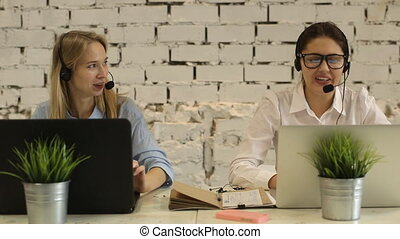 Two customer service representatives at work Two cheerful...