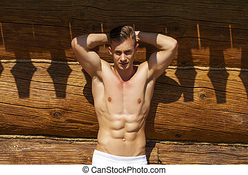 Sexy portrait of a very muscular shirtless male model in the...