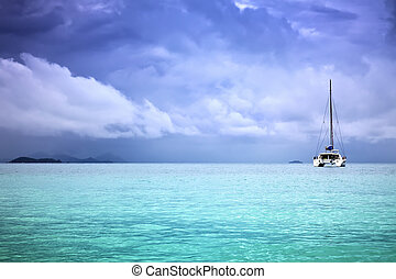 catamaran - A photography of a catamaran in the ocean and...