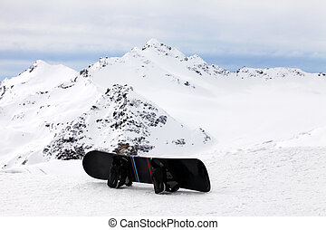 Snowboard on a background of high mountain of Elbrus