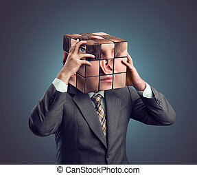 Businessman with cube head - Man holding his  cube head