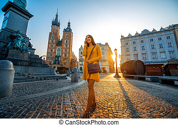Woman walking in the old city center of Krakow - Young and...