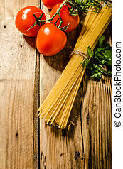 Spaghetti product photo, on wood table with tomatoes and...