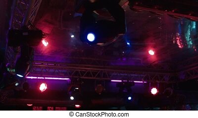 The light equipment at night club - Disco light, dynamic...