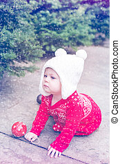 Baby girl - Cute baby girl in red Scandinavian dress at the...