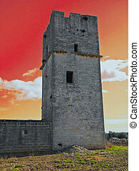 Ancient Red Stones Tower of Giovinazzo at sunset. Apulia.