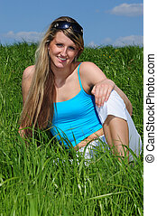 spare time - beautiful young woman on a meadow