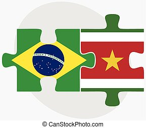 Brazil and Suriname Flags in puzzle isolated on white...