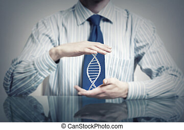 Dna molecule concept - Hands of businessman holding with...