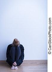 Despair girl in empty room