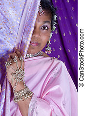 Hiding in silk - Lovely Indian woman wearing a saree, hiding...