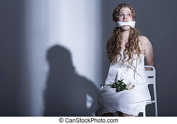 Tied woman with a gag over her mouth
