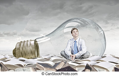Inside of idea - Young thoughtful businessman trapped inside...
