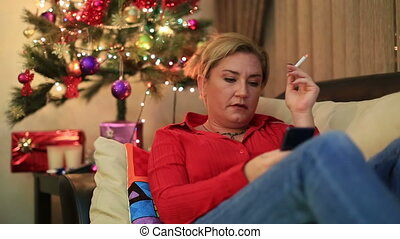 Woman sitting near the xmas tree - Portrait of a lonely sad...