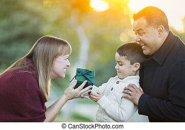 Young Mixed Race Son Handing Gift to His Mom