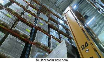 Manufacturing warehouse. View of forklift works, close-up