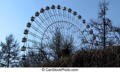 Amusement park View of Ferris wheel - Amusement park at...