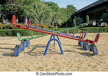old seesaw in kids playground - old seesaw or teeter-totter...