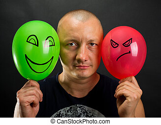 Emotions - Emotionless man between happy and angry balloons