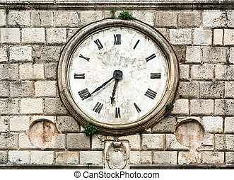 Antique clock on a building.