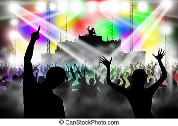 People dancing in night club. DJ playing music