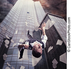 Businessman is falling down from the tall office building