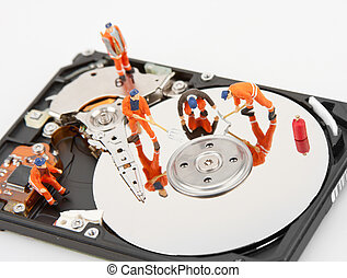 IT support. Workers repairing hard disk drive