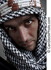 Serious middle eastern man looking to you - Portrait of...