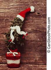 Crochet Christmas tree with scaf and Santa hat, cold winter...