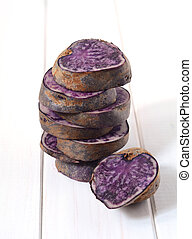 Raw purple potato - Vitolette noir or purple potato with...