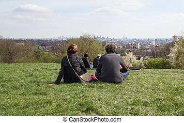 Couple enjoy London Skyline from Parliament Hill - A couple...