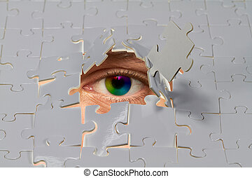 Puzzle - An eye looking out from a hole in a puzzle